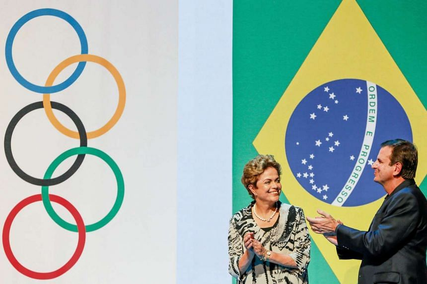 Brazilian President Dilma Rousseff (left) and Rio de Janeiro's Mayor Eduardo Paes (right) during the One Year to Go to the Games of the XXXI Olympiad Rio 2016 ceremony in Rio de Janeiro, Brazil, on August 5, 2015.