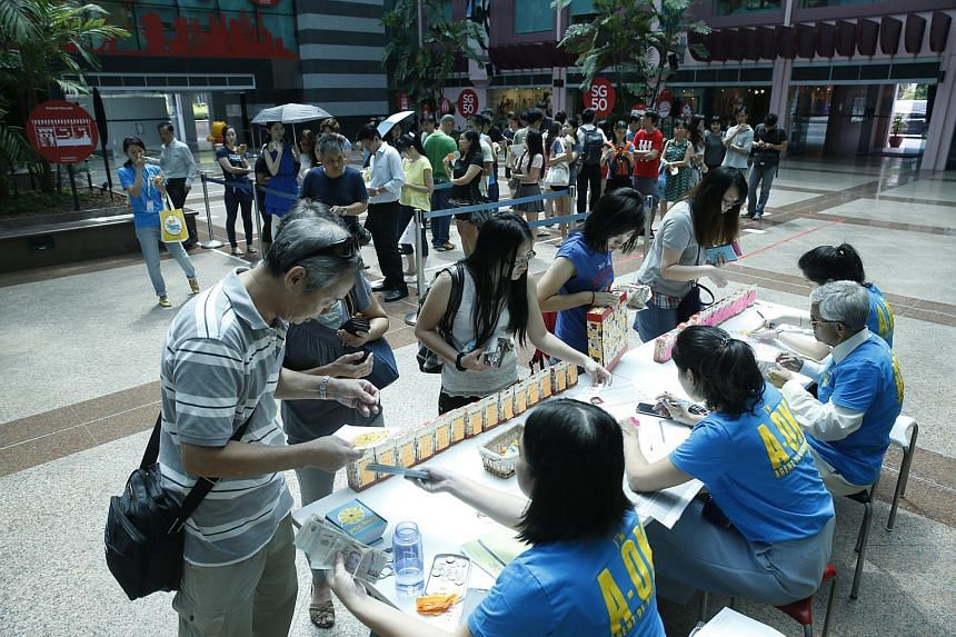 People queueing up for 1,000 limited box sets of Singa figurines, each sold at $300, at Kindness Gallery Old Hill Street Police Station on Aug 11.