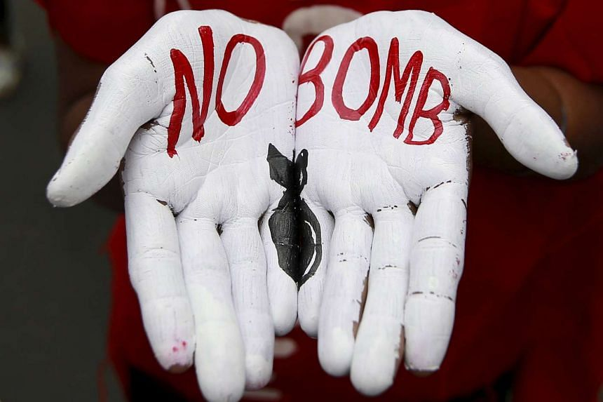 """The words """"No Bomb"""" on a student's palms at a peace rally in Mumbai, India, to mark the 70th anniversary of the atomic bombings in two Japanese cities."""