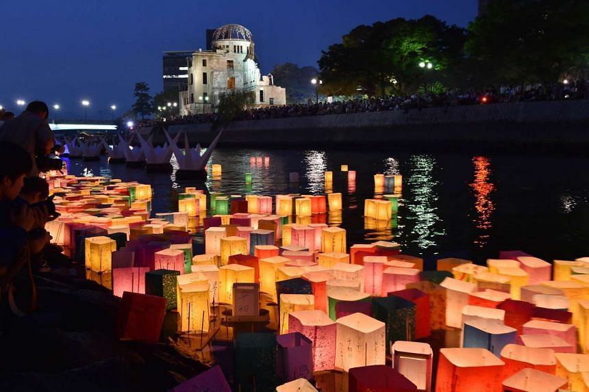 Paper lanterns (above) floating on a river in front of the Atomic Bomb Dome in Hiroshima last Thursday, the 70th anniversary of the Japanese city's bombing by the US.