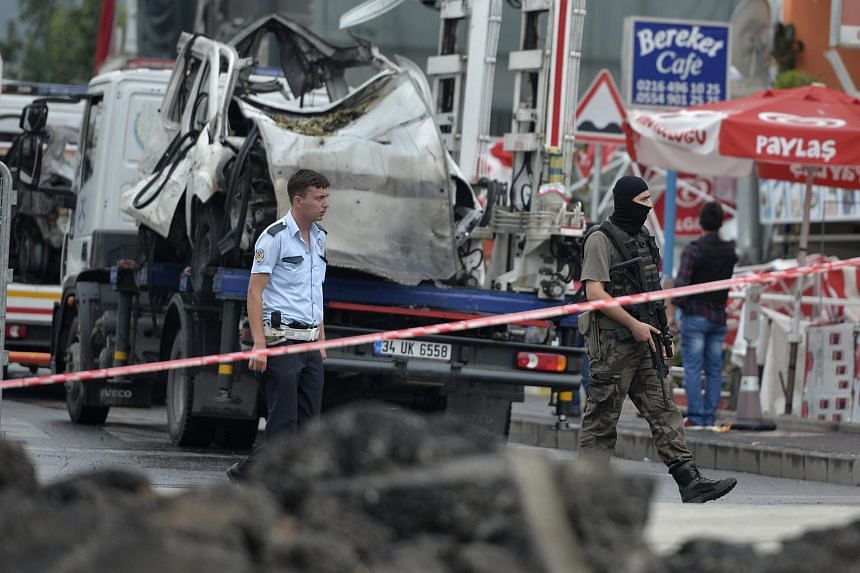 Members of a Turkish special security force secure the residential neighborhood after a bomb attack on a police station in Istanbul, Turkey on Aug 10, 2015.