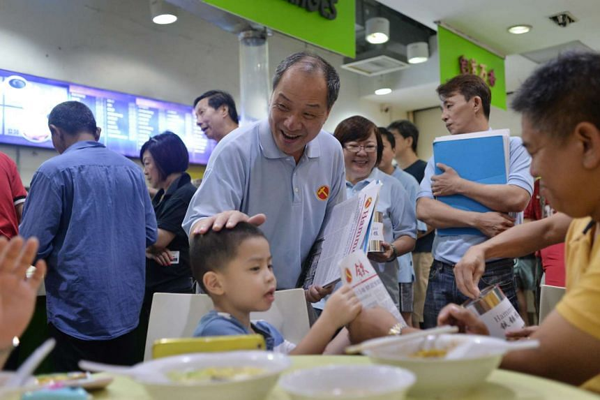 Mr Low Thia Khiang greeting residents in Punggol East Single Member Constituency (SMC) on July 26, 2015.