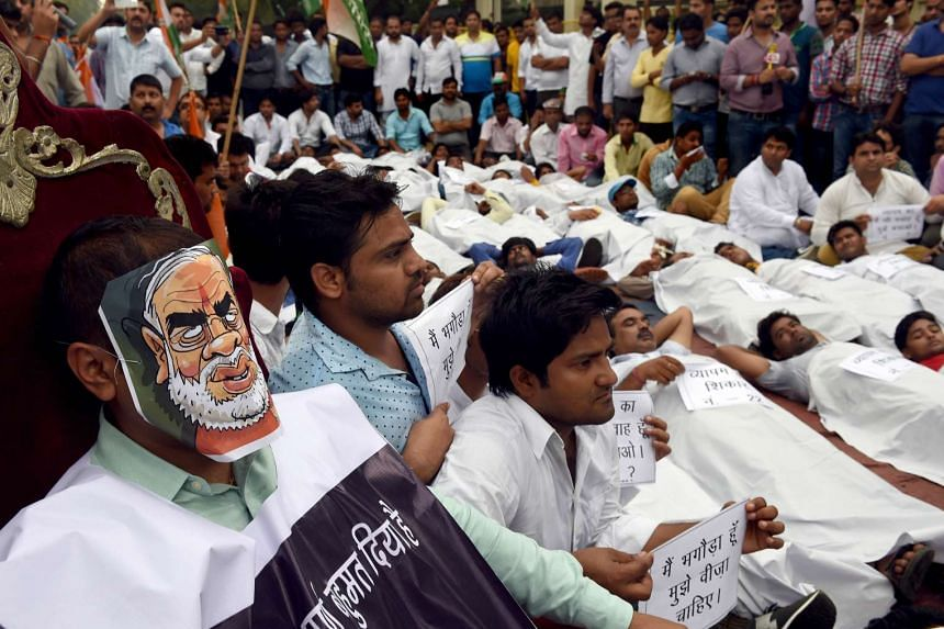 Activists from the Indian Youth Congress (IYC) during a street play as part of a protest near the Indian Parliament in New Delhi on Aug 11, 2015.