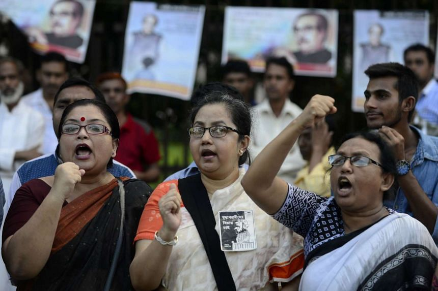 Bangladeshi secular activists take part in a protest against the killing of blogger Niloy Chakrabarti, who used the pen-name Niloy Neel, in Dhaka on Aug 11, 2015.
