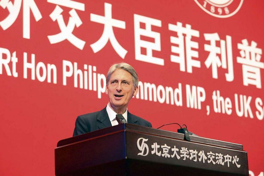 British Foreign Secretary Philip Hammond speaks at Peking University in Beijing on Aug 12, 2015.