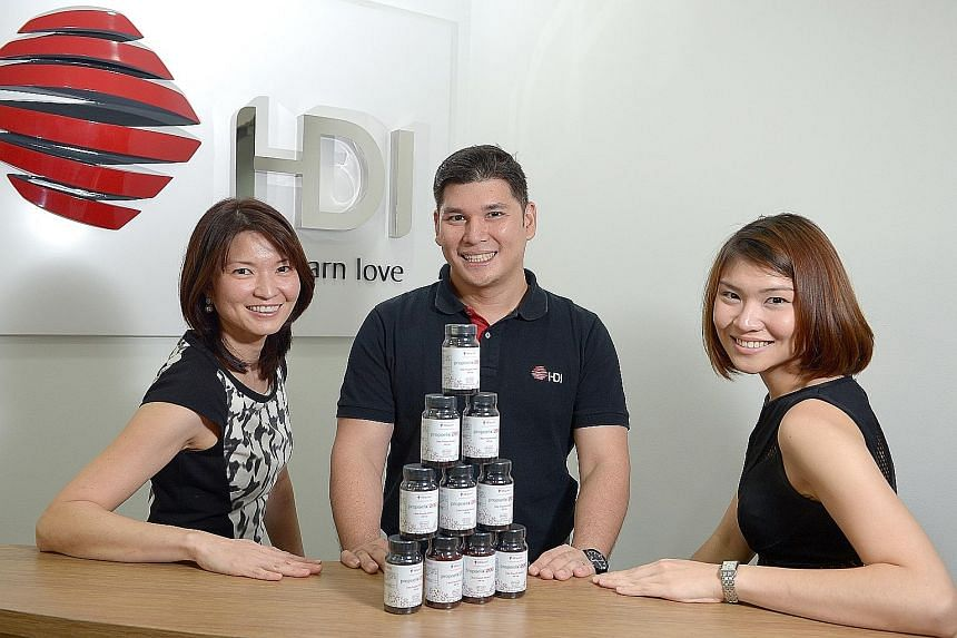 HDI Group chairman Brandon Chia, 37, with his sisters, Dr Chia Su-Ynn (left), 40, and Ms Chia Su-Mae, 26. Their father, company founder Peter Chia, 67, started distributing bee products in 1986 to provide for his family and the siblings gradually got