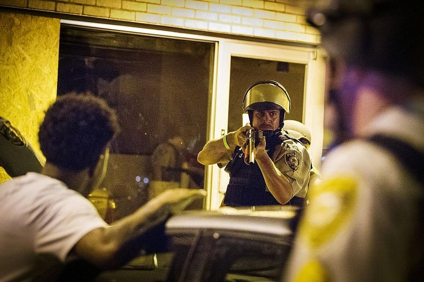 St Louis County police yesterday faced off against demonstrators in Ferguson, Missouri, as violence erupted following the first anniversary of the fatal shooting of black teen Michael Brown by a white police officer.