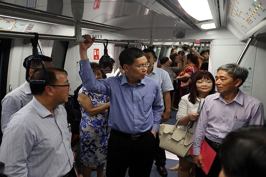Mr Lui Tuck Yew (centre) often travelled on public transport on his own to see the conditions for himself. MP Liang Eng Hwa said in 2011, Mr Lui rode on the Bukit Panjang LRT system during the June school holidays and it was not as crowded as expecte