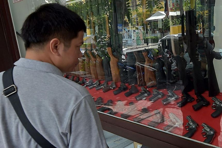Weapons on display at a gun shop in Bangkok. Some 6.1 million firearms are registered in Thailand, which has a population of 67 million. Thailand is awash with firearms, and disputes are all too frequently settled with a bullet and a body.