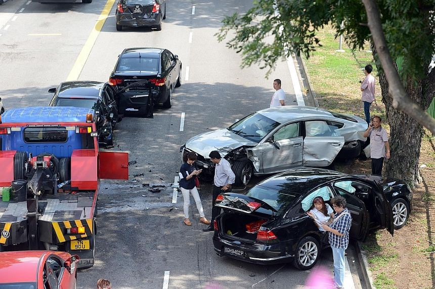 The scene of the crash which took place at about 9am yesterday along Simei Avenue. Witnesses say the driver of the silver Audi - believed to be a young man - was speeding and in the midst of overtaking when his car collided with the other vehicles an