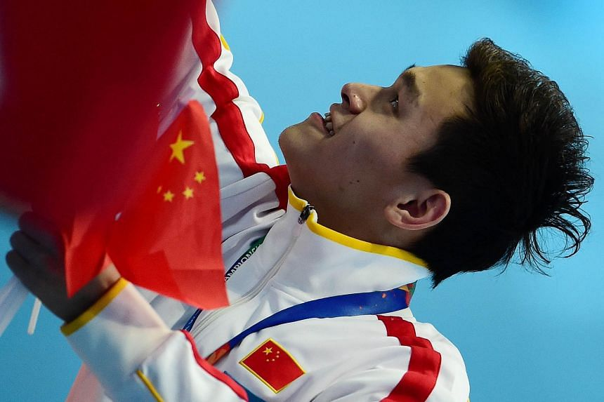 China's Sun Yang celebrates with fans after winning the 800m freestyle in Kazan last Wednesday. The decision by Fina to name Sun as the top male swimmer of the World Championships was widely criticised.
