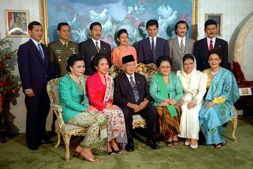 Former president Suharto and Mrs Tien Suharto (seated centre) in a photo with their children and in-laws in Cendana, Jakarta, in 1993. Under the Supreme Court ruling on July 8 but made public only yesterday, the late president's six children and the