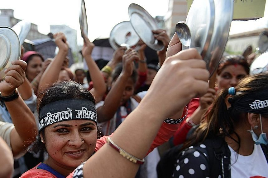 Activists in Nepal banged plates and spoons on Monday as they took part in a protest in Kathmandu to demand equal citizenship rights in the new Constitution. Nepal's Parliament is proposing to bar all single parents from passing on their citizenship