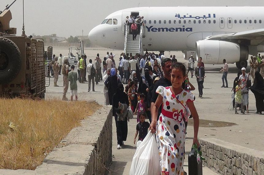 Passengers disembarking from a Yemen Airways plane at the airport in Yemen's southern port city of Aden. Fighters backed by Gulf countries retook the airport from the Houthis last month, in a turning point in the civil war.