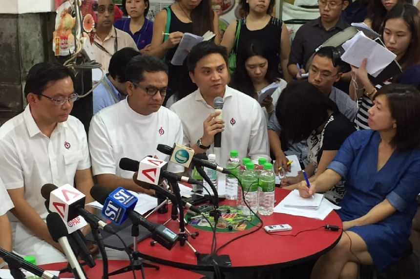 Mr Saktiandi Supaat (third from left) addresses the public during a PAP press conference at a coffeeshop in Toa Payoh central.