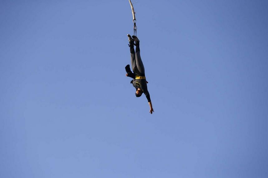 A bungee jumper at a festival in Poland in July 2015.