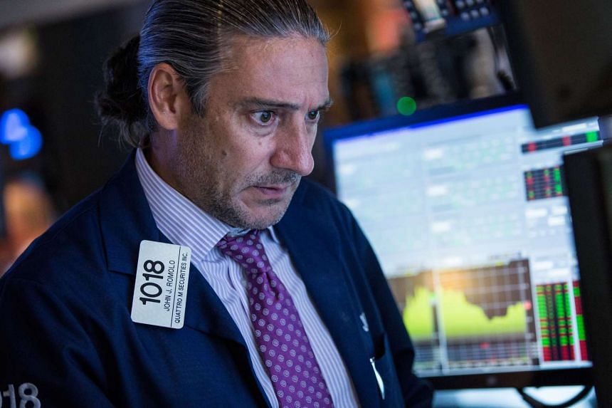 Traders work on the floor of the New York Stock Exchange on Aug 11, 2015 in New York City.