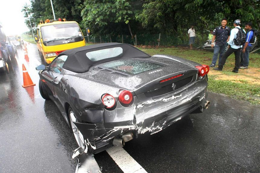 A Ferrari 430 Spyder car spun out of control and crashed while being chased by thugs on the North-South Highway.