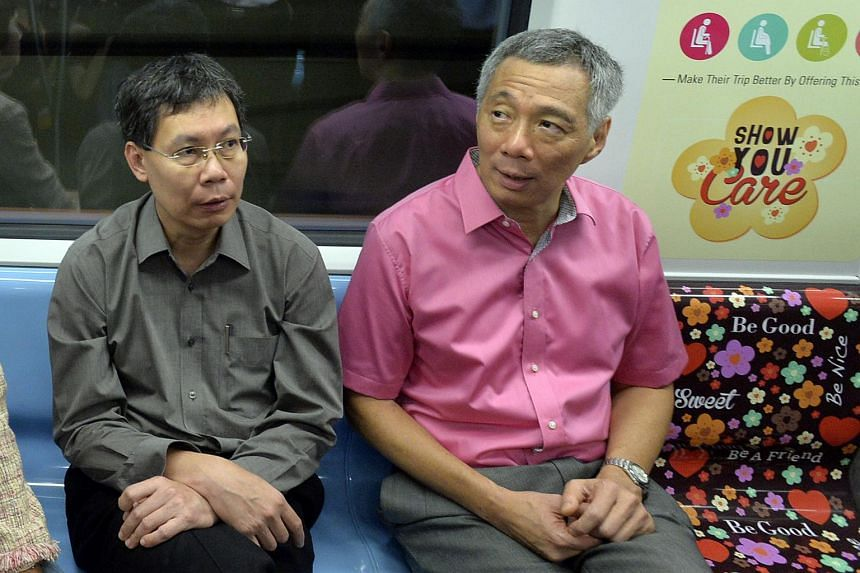 Minister Lui Tuck Yew (left) with Prime Minister Lee Hsien Loong (right) after the opening ceremony of Downtown Line 1.
