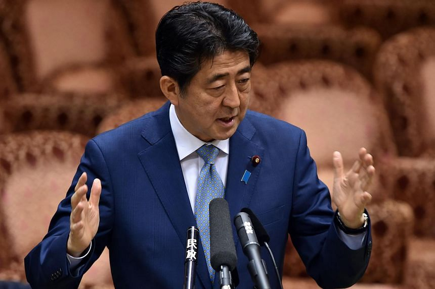 Japan's Prime Minister Shinzo Abe at an Upper House budget committee session on Aug 10, 2015.
