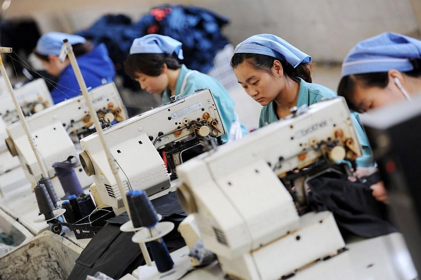 Workers producing clothes at a factory in Huaibei, Anhui province, in May.