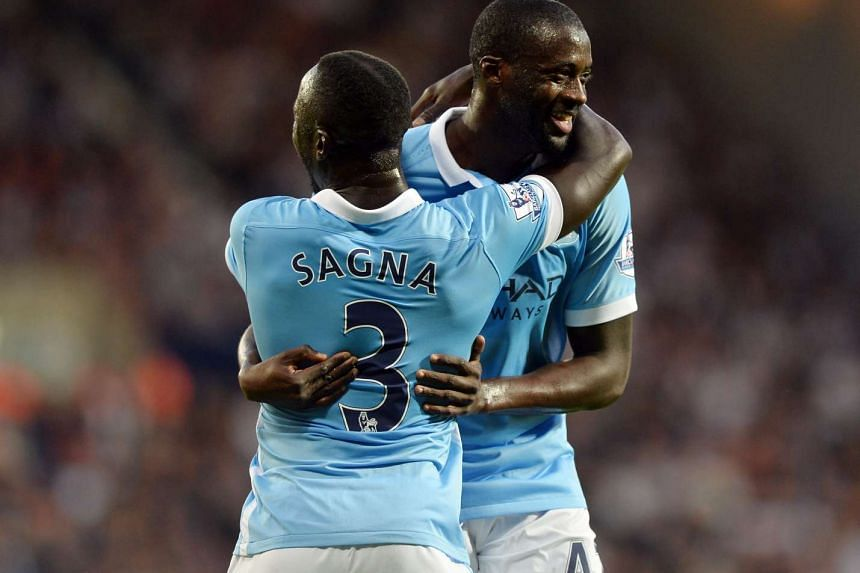 Manchester City's Yaya Toure (right) celebrates with team mate Bacary Sagna (left) after scoring during the  match against West Bromwich Albion.