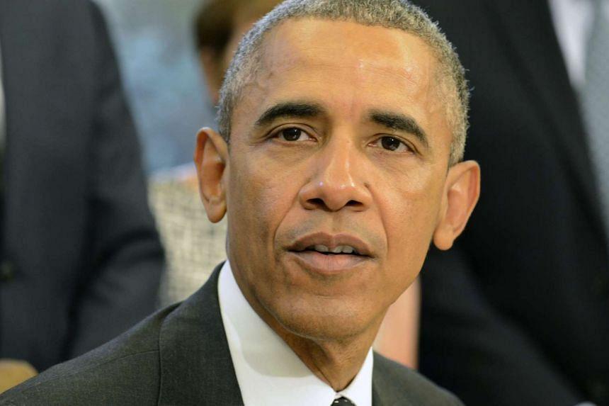 "Ten senators said Obama (above) should make human rights ""a key and public component"" of his talks with Xi."