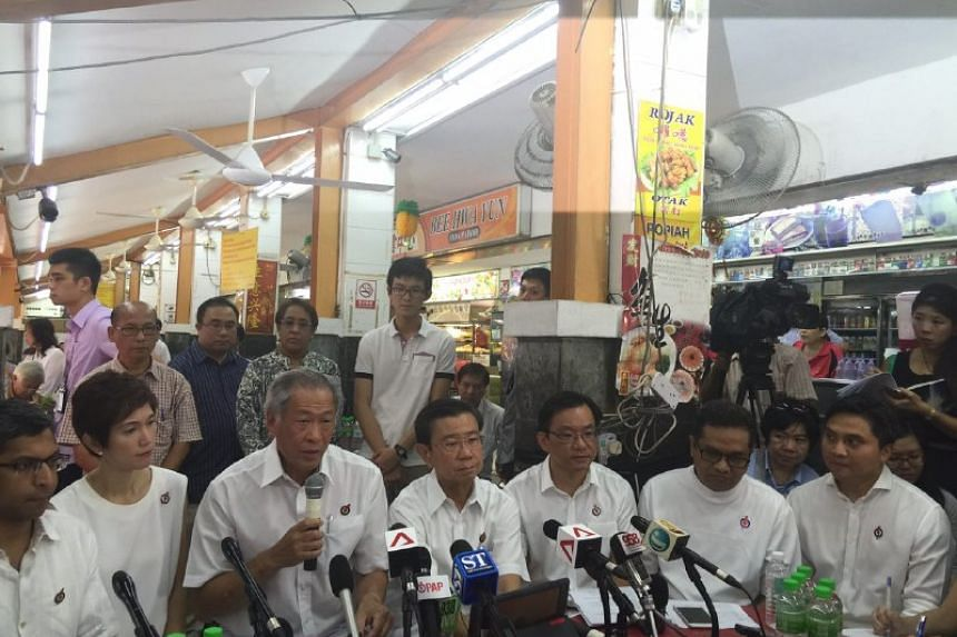 Dr Ng Eng Hen (holding microphone) said they chose to make the announcement in a coffeeshop to send a message that the elections are about the heartlands.