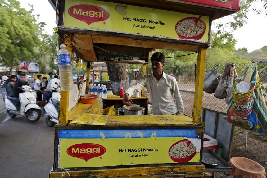 A vendor works at a roadside Maggi noodles eatery in Ahmedabad, India, in a June 4  file photo.