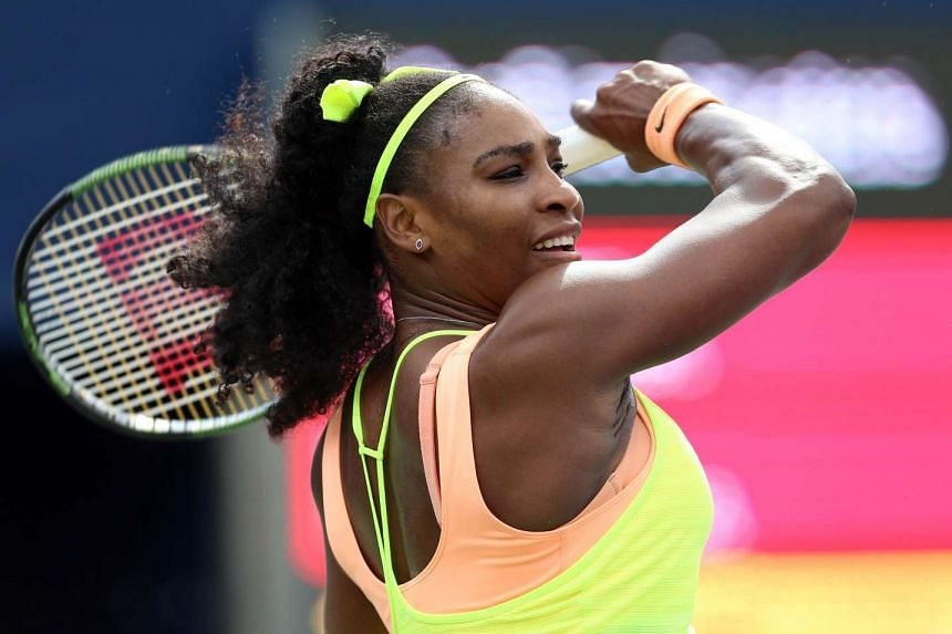 Serena Williams of the USA plays a shot against Flavia Pennetta of Italy during Day 2 of the Rogers Cup at the Aviva Centre on Tuesday in Toronto, Canada.