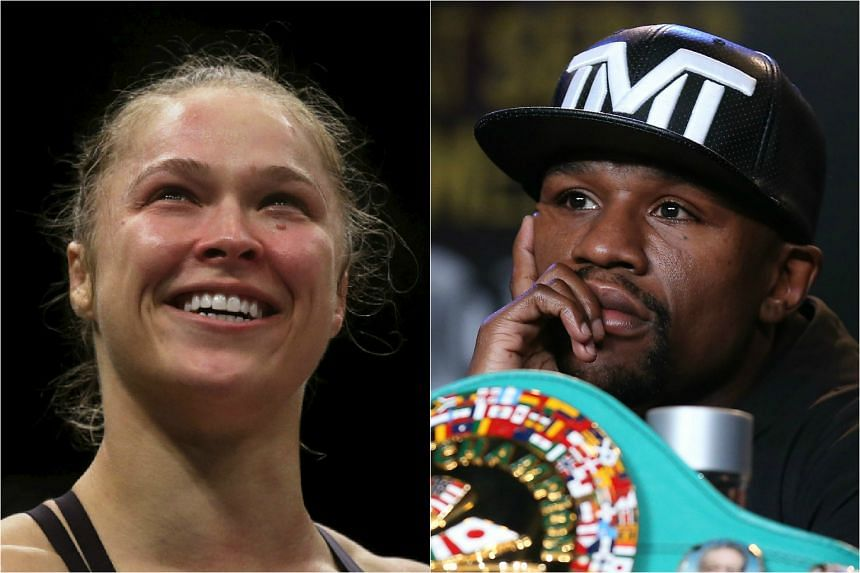 American MMA superstar Ronda Rousey (left) has escalated her public war of words with Floyd Mayweather by saying she would beat him in a 'no-rules' fight.