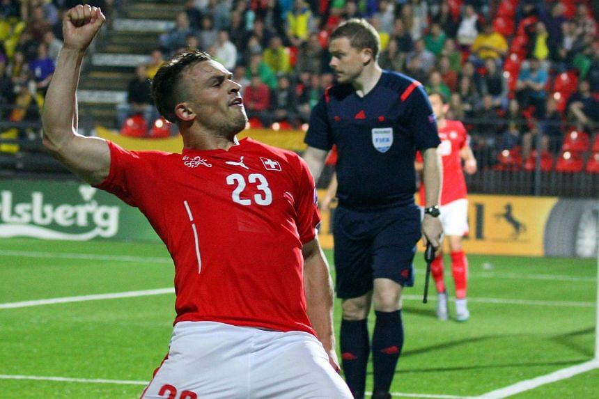 Swiss forward Xherdan Shaqiri celebrating after scoring during a Euro 2016 qualifying match against Lithuania on June 14.