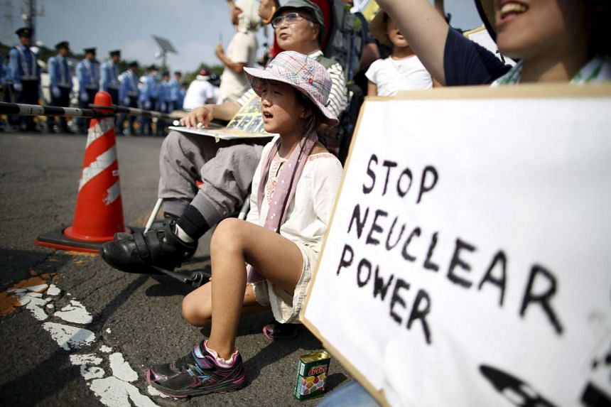 Protesters rallying outside Kyushu Electric Power's nuclear power station in Sendai, Kagoshima prefecture. Japan yesterday turned on a nuclear reactor there, after nearly two years of being nuclear-free.