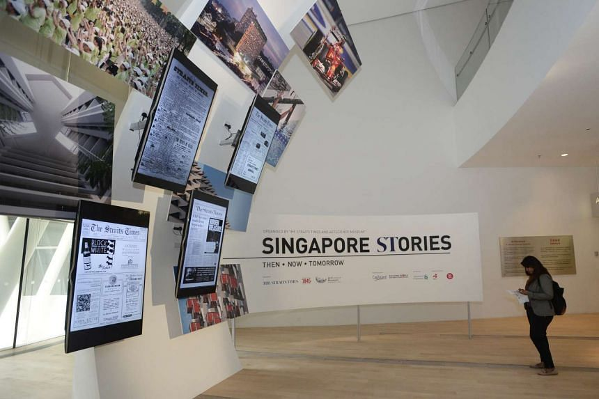 TAKE IN DIGITAL DISPLAYS: These four LG 55-inch flatscreen television sets showcase more than 43,000 front pages of The Straits Times from 1845 to 2015.