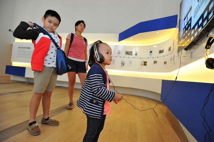 VIEW VIDEO ARCHIVES: Visitors young and old can check out the dozen LG 55-inch Oled TV sets, provided by LG equipment sponsor Best Denki, playing 18 videos mostly from the ST archives.