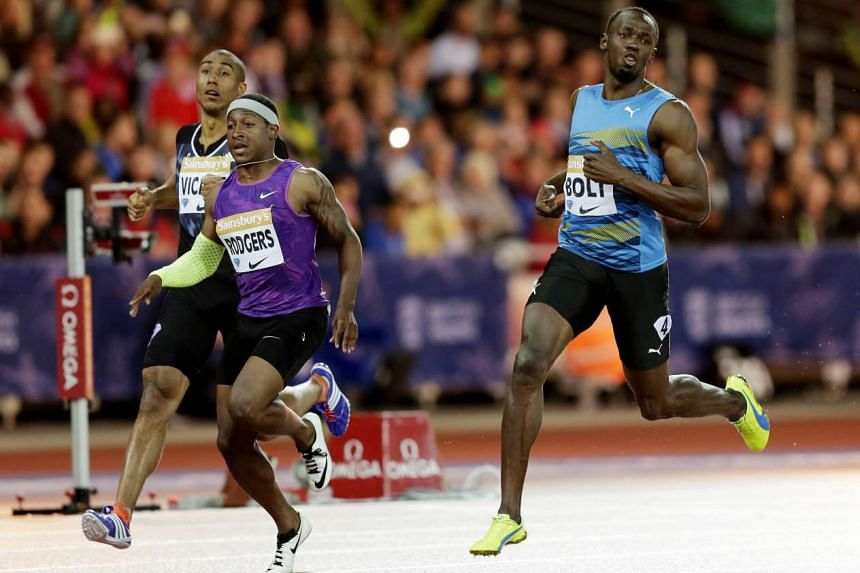 Usain Bolt (right), winning the 100m in London last month, headlines a 53-member Jamaican squad for the Beijing World Championships.