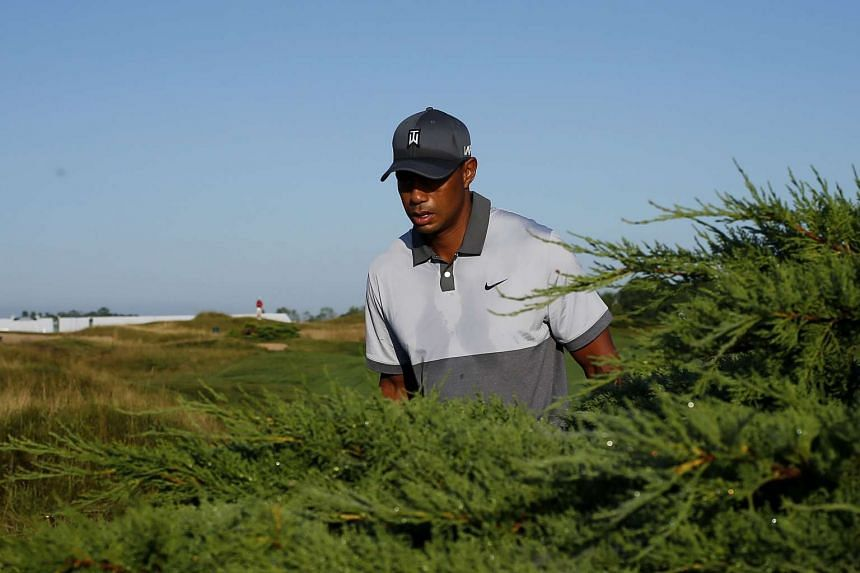Woods walks to the second hole during a practice round prior to the 2015 PGA Championship at Whistling Straits.