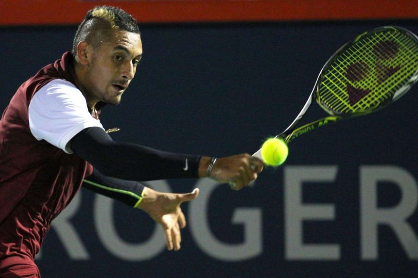 Nick Kyrgios of Australia hits a shot against Stan Wawrinka of Switzerland during the Rogers Cup tennis tournament at Uniprix Stadium in Montreal, Canada on Aug 12, 2015.