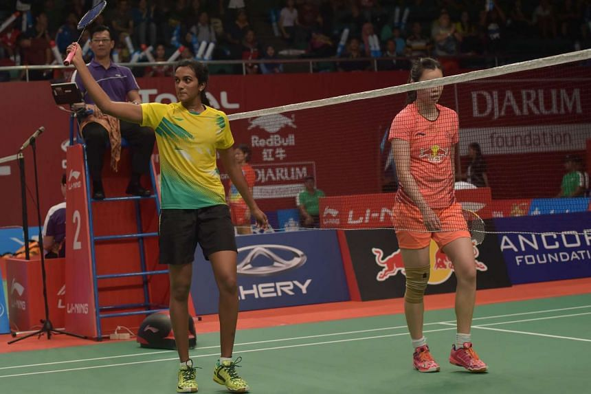 P.V. Sindhu (left) of India celebrates after defeating Li Xuerui of China in their women's singles match at the 2015 World Championships badminton tournament in Jakarta on Aug 13, 2015.