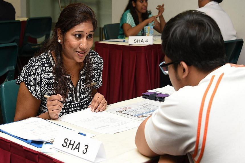 Student health adviser Mageswari D.N. Amaderlingam, 39, offering health advice to a student at ITE College Central yesterday. Advisers help young people to quit smoking or lose weight.