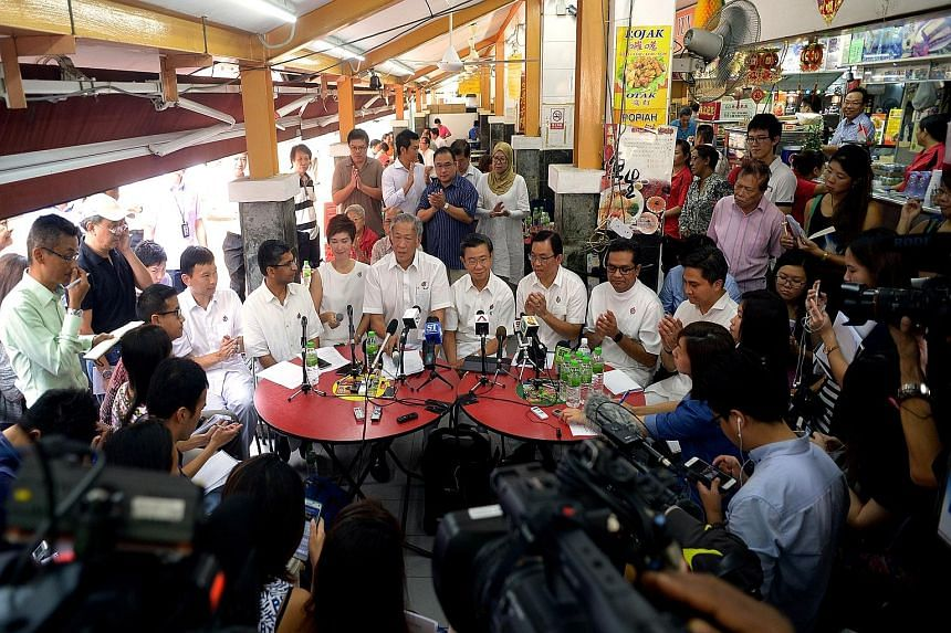 At yesterday's press conference in Toa Payoh were PAP members (from left) Chee Hong Tat, Hri Kumar Nair, Josephine Teo, Ng Eng Hen, Wong Kan Seng, Chong Kee Hiong, Zainudin Nordin and Saktiandi Supaat. Mr Chee, Mr Chong and Mr Saktiandi are the new c