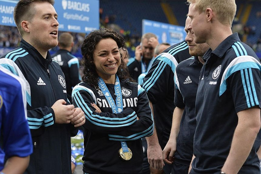 Chelsea first team doctor Eva Carneiro (centre) celebrating with a Premier League winner's medal last season. Coach Jose Mourinho was furious with both her and physio Jon Fearn for entering the pitch to treat Eden Hazard in stoppage time when Swansea