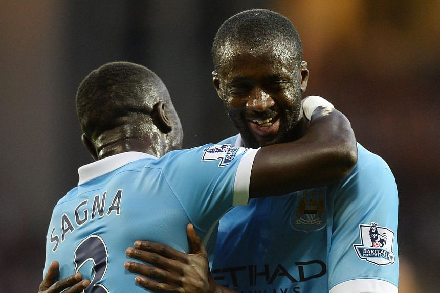Manchester City's Yaya Toure (right) celebrates with Bacary Sagna after scoring his second goal in the 3-0 victory over West Bromwich on Monday.