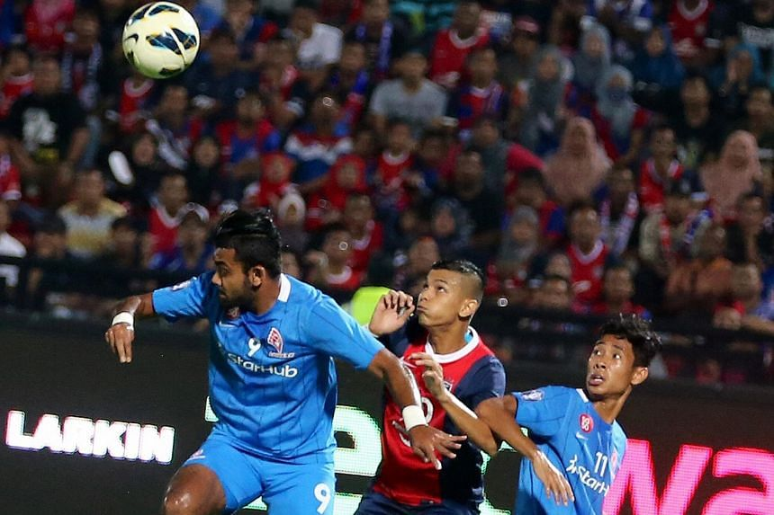 LionsXII right-back Faritz Abdul Hameed (left) and right winger Nazrul Nazari (right) defending against Johor Darul Takzim's Nazrin Nawi yesterday. The defending MSL champions won 1-0 with a goal from Luciano Figueroa.