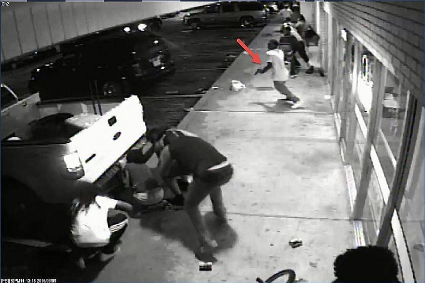 In this 13-second clip, police say the man indicated by the arrow is Tyrone Harris, who has been accused of firing on the police.