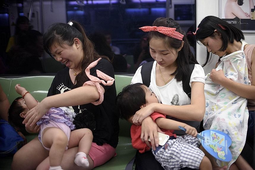 Mothers breastfeeding their babies in a subway station during the recent World Breastfeeding Week. China wants to raise breastfeeding rates to 50 per cent by 2020.