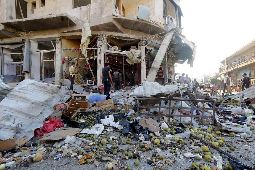 Residents gathering on Tuesday at a vegetable market damaged by what activists said was an air strike by the forces of Syrian President Bashar al-Assad. Having lost large sections of the country to the ISIS and various rebel forces, the Syrian govern