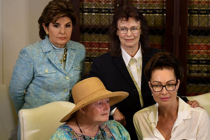 Attorney Gloria Allred (backgound left) and three alleged sexual assault victims of comedian Bill Cosby (left to right) Colleen Hughes, Linda Ridgeway Whitedeer and Eden Tirl attend a news conference in Los Angeles, California on Aug 12, 2015.