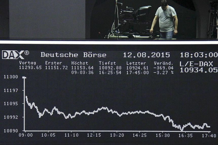 A man stands at the balcony over the DAX board at the Frankfurt stock exchange in Frankfurt, Germany on Aug 12, 2015.