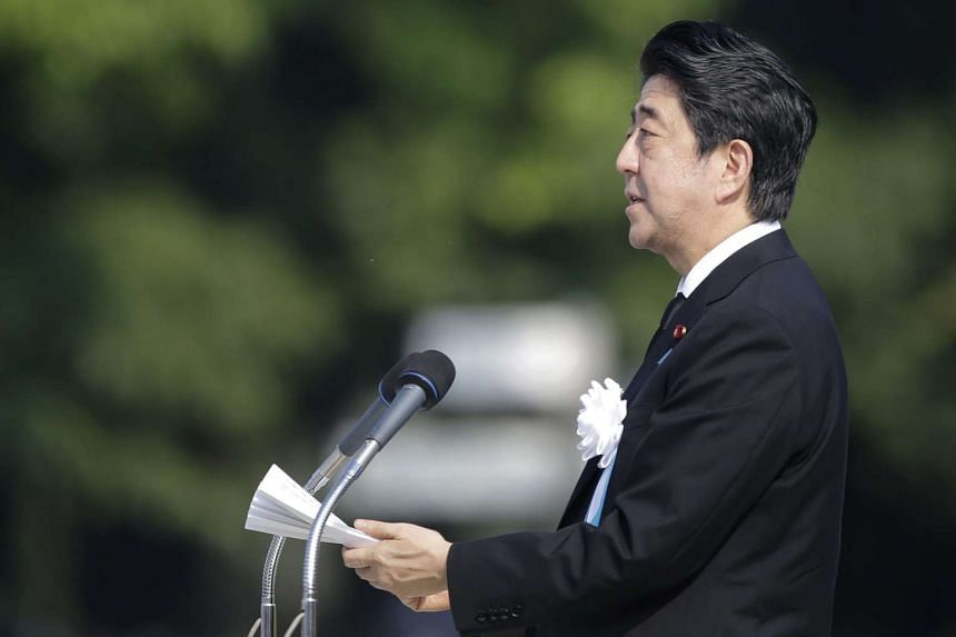 Japanese Prime Minister Shinzo Abe delivers a speech during the peace memorial ceremony marking the 70th anniversary of the nuclear bombing of Hiroshima at the Hiroshima Peace Memorial Park on Aug 6, 2015.